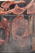 picture of charcoal  - grilled roast meat lamb ribs on barbecue grid over charcoal - JPG