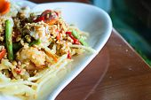 stock photo of green papaya salad  - papaya salad with horse crab close up  - JPG