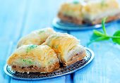 picture of dessert plate  - Baklava Turkish dessert on metal plate and on a table