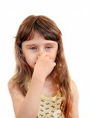stock photo of girlie  - Little Girl close the Nose Isolated on the White Background - JPG