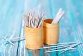 stock photo of gingivitis  - wooden toothpicks on the green table toothpick on wooden backgrounds - JPG