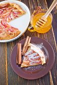 picture of pie-in-face  - apple pie on plate and on a table - JPG