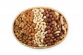 foto of mixed nut  - Mix nuts in wicker basket isolated on white background - JPG