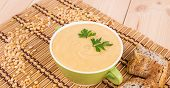foto of peas  - Pea soup in a green bowl with parsley - JPG