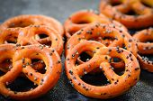 pic of pretzels  - Fresh baked pretzels covered in poppy seeds - JPG