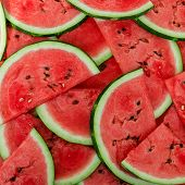 stock photo of watermelon slices  - a Background of fresh ripe watermelon slices - JPG