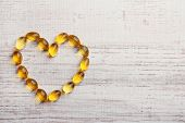 stock photo of cod  - Heart of cod liver oil - JPG