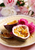 foto of passion fruit  - Passion fruit on plate on color wooden background - JPG