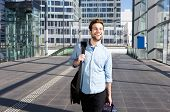 stock photo of leaving  - Portrait of a happy man at airport leaving for vacation - JPG
