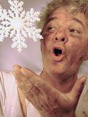 Dirty Senior Man With Beautiful Snowflake