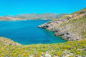 foto of greek-island  - Peaceful azure sea bay with clear water on Greek island - JPG