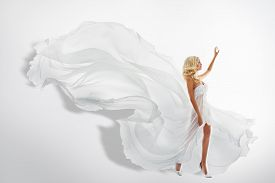 image of waving hands  - Woman White Waving Dress Showing Hand Up Flying Fabric Silk Cloth Flowing on wind - JPG