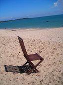 Single Deck Chair Facing Beach In Desaru, Malaysia