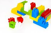 House Building From Lego Bricks On A White Background poster