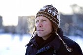 pic of ruddy-faced  - Portrait of breathing man in winter hat - JPG