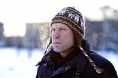 stock photo of ruddy-faced  - Portrait of breathing man in winter hat - JPG