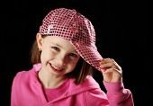 Female Child Wearing Pink Sparkly Baseball Cap