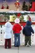 Kids At Christmas Display