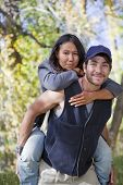 image of native american ethnicity  - Young multi ethnic couple in autumn forest - JPG
