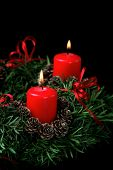 Two red burning candles