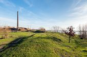 Постер, плакат: Undulating Landscape With An Old Brick Factory