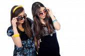 Two modern girls teenagers. Isolated over white background.