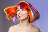 Woman hair as color splash. Rainbow up do short haircut. Beautiful young girl model with glowing  he poster