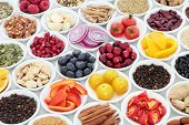Food for a healthy heart with herbal medicine, vegetables, fruit, pulses, seeds and nuts on white ba poster