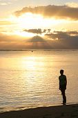 Woman Looking At The Sunset Over Mauritius poster