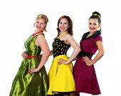 picture of poodle skirt  - three stylish young woman in bright colour dresses - JPG