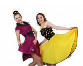 stock photo of poodle skirt  - two stylish young woman in bright colour dresses - JPG