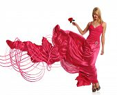 stock photo of evening gown  - Portrait of beautiful young woman in pink evening gown holding rose - JPG