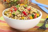 foto of quinoa  - Delicious vegetarian quinoa salad with bell pepper cucumber and tomatoes  - JPG