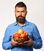 Man With Beard Holds Wicker Bowl With Fruit poster