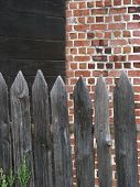 Wooden Fence And Brick Wall