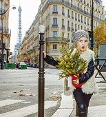 Modern Funny Child With Christmas Tree In Paris, France poster