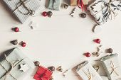 Christmas Flat Lay. Present Boxes With Ornaments On White Wooden Background Top View, Space For Text poster