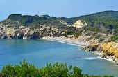 stock photo of nudist beach  - View of Home Mort Beach in Sitges - JPG