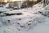 Frozen Waterfall In Mountain Stream