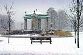 stock photo of muni  - winter snow on park bench and gazebo in front of muny opera house - JPG