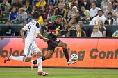 CARSON, CA. - MAY 7: New York Red Bulls F Thierry Henry #14 (R) gets past Los Angeles Galaxy D Omar