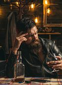 Drinking Man. Man With Beard Holds Glass Brandy. Man Holding A Glass Of Whisky. Sipping Whiskey. Deg poster