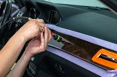 The Polisher Polishes The Interior Wood Trim Of The Vehicle With Special Wax To Protect The Car From poster