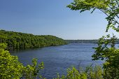 St. Croix River - A Scenic River View With A Town In The Distance. poster