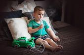 Three Year Old Boy Making Inhalation With Nebulizer At Home. poster