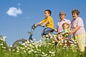 pic of old couple  - Ride with grandparents outdoors among daisies in spring or summer time - JPG