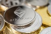 Ethereum Physical Coin On The Stack Of Other Different Cryptocurrencies. Ethereum Cryptocurrency Coi poster