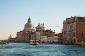 Basilica Di Santa Maria Della Salute With Vaporetto Floating At Grand Canal