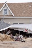 LAVALLETTE, NJ - JAN 13: Twisted bicycles in front of the remnants of a home on January 13, 2013 in Lavallette, New Jersey. Clean up continues 75 days after Hurricane Sandy struck in October 2012.