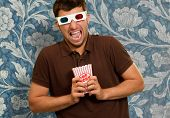 Young Man Wearing 3d Glasses On Wallpaper